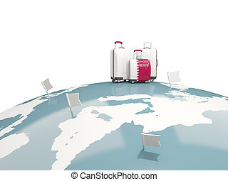 Luggage with flag of qatar. Three bags on top of globe