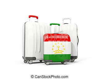 Luggage with flag of tajikistan. Three bags isolated on white