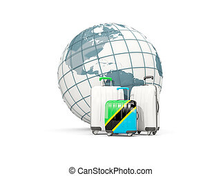 Luggage with flag of tanzania. Three bags in front of globe