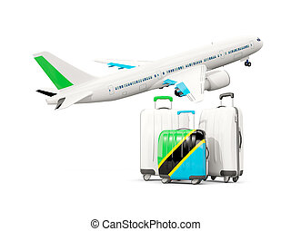 Luggage with flag of tanzania. Three bags with airplane