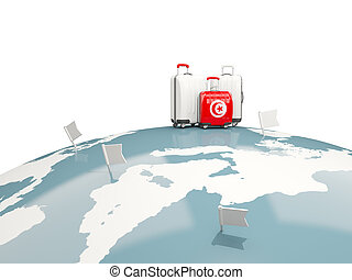 Luggage with flag of tunisia. Three bags on top of globe