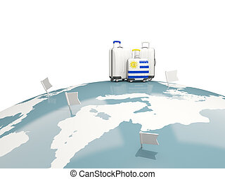 Luggage with flag of uruguay. Three bags on top of globe
