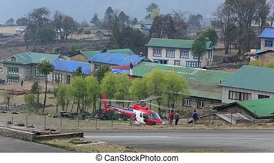 Helicopter takes - LUKLA, NEPAL - APRIL 2: Tenzing-Hillary...