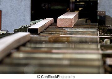 Lumber coming of the conveyer belt in a saw mill