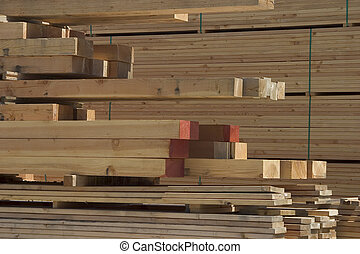 Lumber - A pile of lumber at a lumberyard.