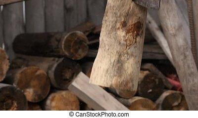 Lumberjack chopping firewood, splitting wood with axe. slow...