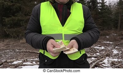 Lumberjack counting euro banknotes and show thumb up