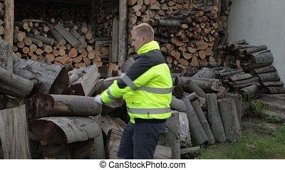 Lumberjack in reflective jacket. Man woodcutter hold huge ...
