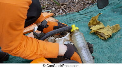 Lumberjack refuelling motor saw 4k - Lumberjack refuelling ...