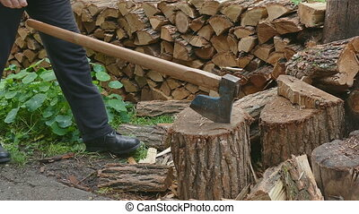 Lumberjack splitting firewood logs - Lumberjack chopping...