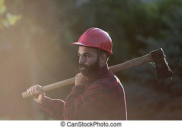 Lumberjack with ax and helmet