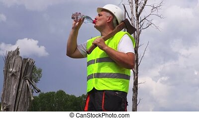 Lumberjack with ax drinking water