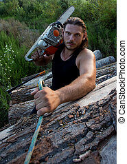 Lumberjack with chainsaw climbing on logs