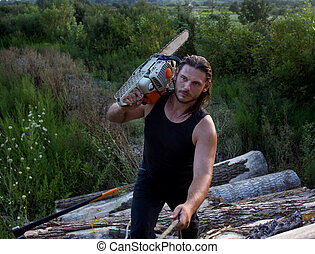 Lumberjack with chainsaw on logs