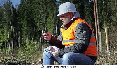 Lumberjack with money and cell phon