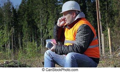 Lumberjack with money talking