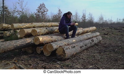 lumberman typing sms on smart phone outdoors. - Adult...