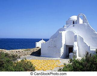 Luminance - Church and fishing nets drying on the greek...