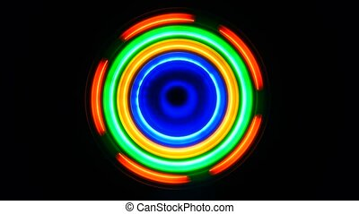 luminous abstract wheel on a black background