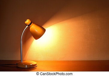 Luminous Desk Lamp - Modern yellow luminous desk lamp on the...