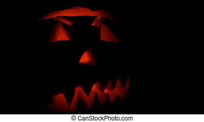 Luminous grimace carved on the Halloween pumpkin to the Day...