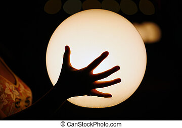 Luminous sphere - Hand on a background of a luminous sphere