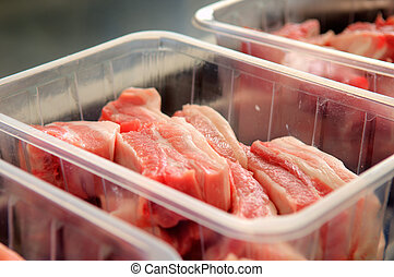 Lumps of meat in a container - Workers taking the lumps of ...