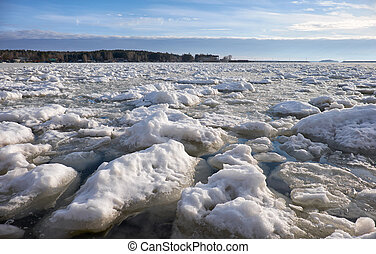 Lumps of snow and ice frazil on the surface of the freezing river water of Ob sea in early winter season