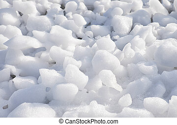 Lumps of snow and ice frazil on the surface of the freezing river water in early winter
