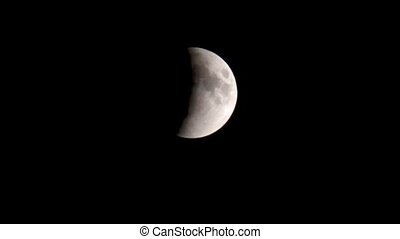 Lunar eclipse: moon moves into the Earth's shadow. Moon moving in real time.