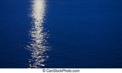 Lunar path - Beautiful lunar path reflection on a dark blue...