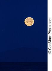 Lunar reflections brightens the dark sky.