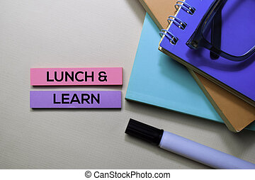 Lunch and Learn text on sticky notes isolated on office desk