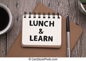 Lunch and Learn, text words typography written on book against wooden background, life and business motivational inspirational