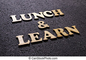 Lunch and Learn. wooden lettering typography concept