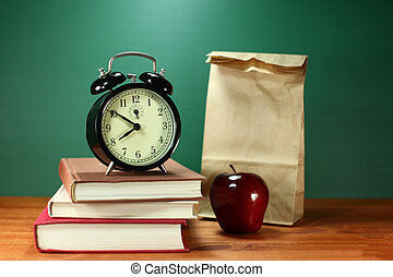 Lunch, Apple, Books and Clock on Desk at School - Back to...
