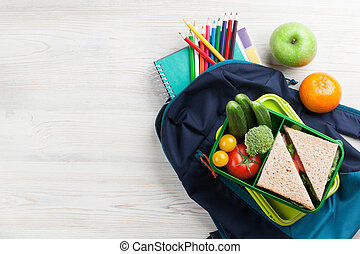 Lunch box and school supplies - Lunch box with vegetables...