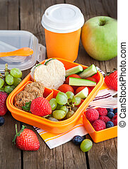 Lunch box with sandwich, cookies, veggies and fruits - Lunch...
