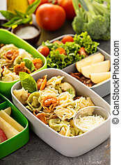 Lunch boxes with food ready to go for work or school, ahead...