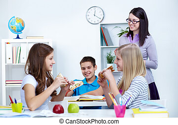Lunch break - Hungry students eating sandwiches during break...