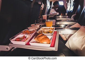 Lunch in airplane. Inflight economy class meal on tray