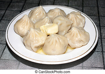 Hot delicious dumplings as part of a meat meal