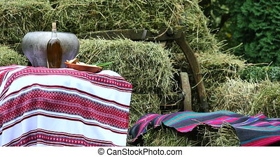 lunch on bales of hay. woven cloths in the manger. Food with...
