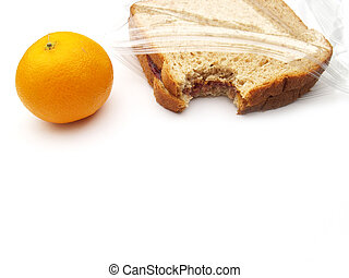 lunch - sandwich and orange - a lunch on the go - orange and...