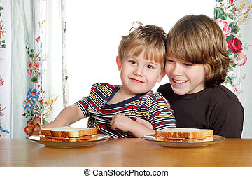 Lunch time - a teenaged boy and his younger brother are...