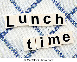 Lunch time, alphabets block on table cloth background