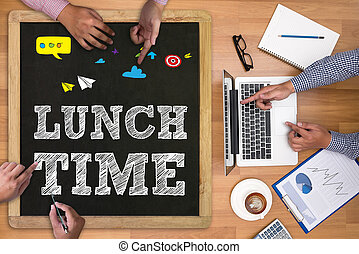 LUNCH TIME Businessman working at office desk and using...