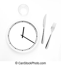 Lunch time concept - Clock with knife, fork and glass for...