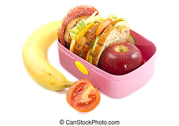 Lunch time - Lunchbox with banana and tomato isolated over...