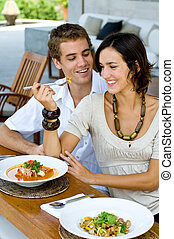 Lunch Together - A young couple on vacation eating lunch at...